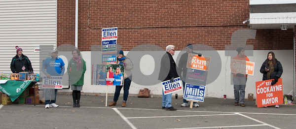 11/7/17 Wesley Bunnell | Staff Supporters of both Democratic challenger Ellen Zoppo-Sassu and Incumbent Mayor Ken Cockayne stand outside of the Elks Club on Tuesday afternoon including Democratic challenger Ellen Zoppo-Sassu, 3rd from the L.