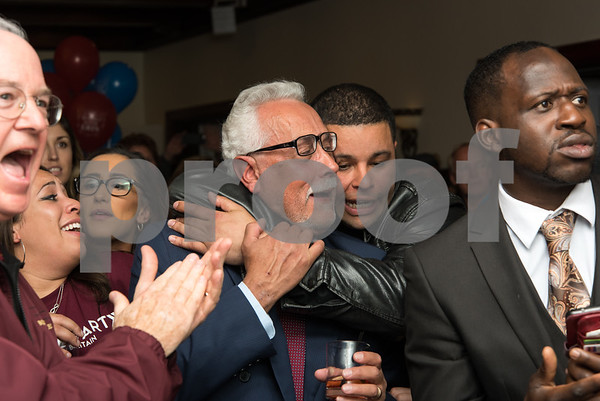 11/7/17 Wesley Bunnell | Staff Team Stewart at their election night headquarters at The Back Nine Tavern at Stanley Golf Course. Alderman Daniel Salerno receives a hug from Alderman Kristian Rosado after winning re-election.