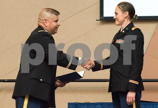 11/09/17 Wesley Bunnell | Staff CCSU held a Veterans Day Observance Ceremony on Friday afternoon in Alumni Hall. CCSU student and CT Army National Guard Chief Warrant Officer 2 Tasha E. Dow receives an award from Major Gutierrez, L,