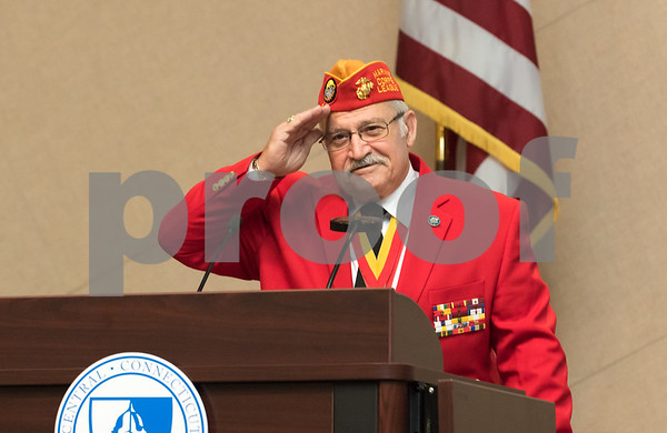 11/09/17 Wesley Bunnell | Staff CCSU held a Veterans Day Observance Ceremony on Friday afternoon in Alumni Hall. CCSU alumn and Marine Corps veteran Salvatore V. Sena Sr. salutes the crowd.