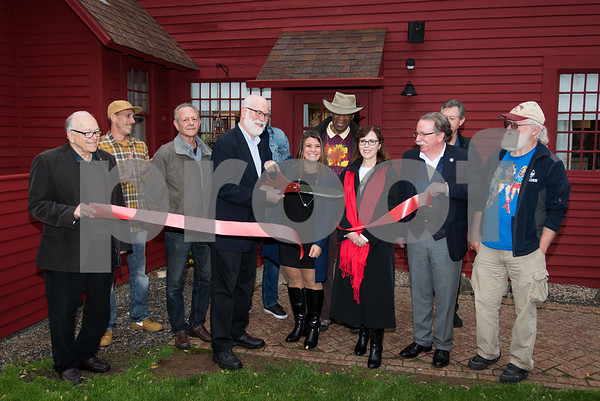 11/1/17 Wesley Bunnell | Staff A ribbon cutting was held at the Art League of New Britain on Wednesday to mark the completion of $40,000 in improvements to the exterior. President of the league Paul Baylock cuts the ribbon along with Mayor Erin Stewart.