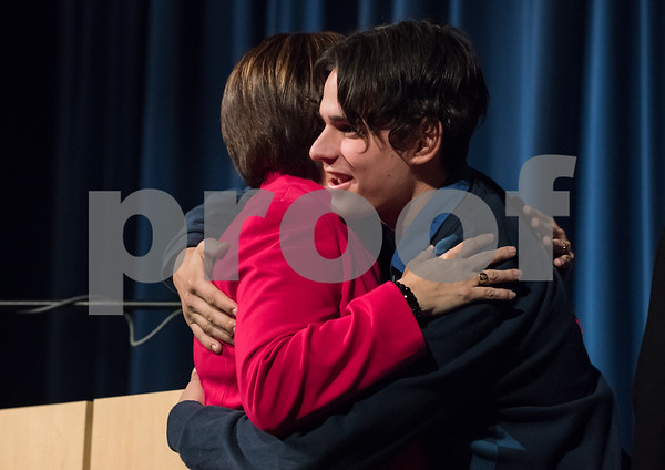 11/13/17 Wesley Bunnell | Staff The City of Bristol held their 2017 Inaugural on Monday evening at Bristol Eastern High School. Mayor Ellen Zoppo-Sassu hugs her son Carson after receiving the oath.