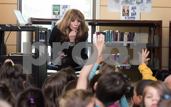 11/13/17 Wesley Bunnell | Staff West Bristol School held its Just Wanna See You Be Brave day featuring anti-bullying programs for all grade levels. Library Media Clerk Judy Michaud answers questions from kindergarten students.