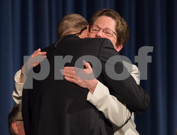 11/13/17 Wesley Bunnell | Staff The City of Bristol held their 2017 Inaugural on Monday evening at Bristol Eastern High School. Mary Fortier for City Council District 3 hugs David Fortier after the oath.