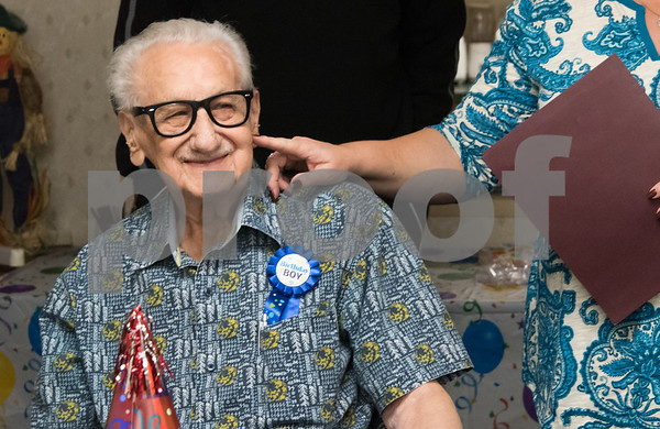 11/14/17 Wesley Bunnell | Staff Jerry DeVito, age 100, celebrated his birthday along with Leon Hatoff, age 104, at Franklin Square Manor on Tuesday afternoon. DeVito smiles as Property Manager Bonny Boehnert touches his cheek.