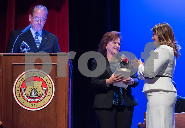 11/14/17 Wesley Bunnell | Staff The inauguration of Mayor Erin E. Stewart and other elected officials was held on Tuesday morning at New Britain High School. Former Mayor Timothy Stewart gives the oath to New Britain's 40th Mayor Erin E. Stewart as wife Patty holds the bible.