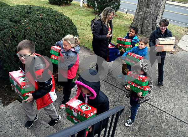 11/14/2017 Mike Orazzi | Staff Immanuel Lutheran School students as they drop off boxes of donated items for Operation Christmas Child at the Calvary Advent Church in Bristol Tuesday afternoon.
