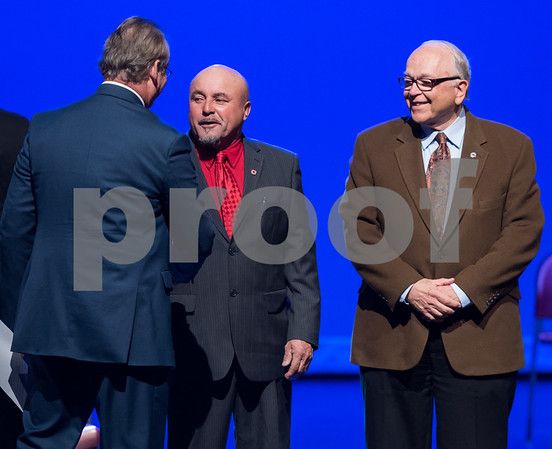 11/14/17 Wesley Bunnell | Staff The inauguration of Mayor Erin E. Stewart and other elected officials was held on Tuesday morning at New Britain High School. Town and City Clerk Mark H. Bernacki, L, shakes hands with Common Council member Wilfredo Pabon as Don Naples looks on.
