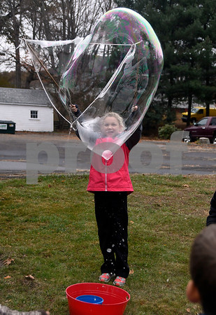 11/14/2017 Mike Orazzi | Staff Immanuel Lutheran School's Elizabeth Hathaway makes a giant bubble after dropping off boxes of donated items for Operation Christmas Child at the Calvary Advent Church in Bristol Tuesday afternoon.