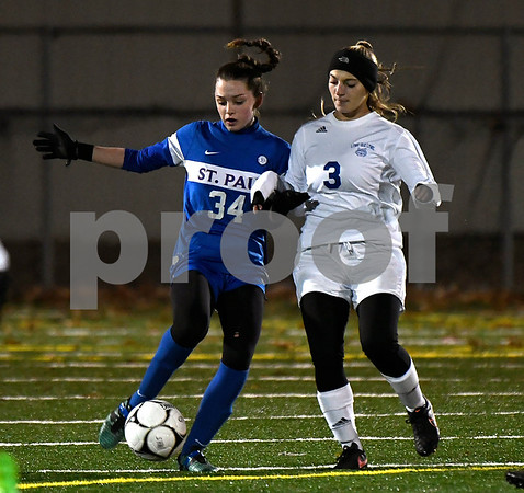 11/14/2017 Mike Orazzi | Staff St. Paul's Hannah Stanford (34) and Old Lyme's Bianca Tinnerello (3) during the Class S Semifinals Girls Soccer at Falcon Field in Meriden Tuesday night.