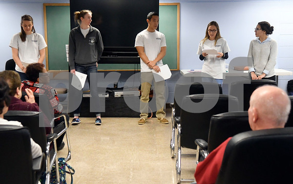 11/15/2017 Mike Orazzi | Staff UConn dental students left to right: Emily Keller, Rachel Legg, Patrick Lau, Alexandra Villalba and Jillian McColgan talk with seniors at the Bristol Senior Center about dental health Wednesday morning.