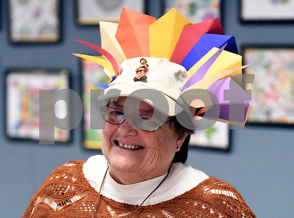 11/15/2017 Mike Orazzi | Staff Ellen Judd while listening to Bristol Board of Education pre-school students sing at the Bristol Senior Center as part of their Thanksgiving Day celebration Wednesday.
