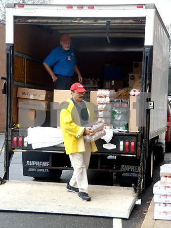11/16/2017 Mike Orazzi | Staff Bristol Hospitals Lou Therrien and Mike Jarry while unloading food for area needy at the Bristol Hospital WIC Program on Prospect Street Thursday morning. Staff assembled Thanksgiving food packages for local families courtesy of donations from the Bristol Hospital Medical Staff.