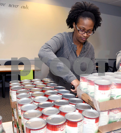 11/16/2017 Mike Orazzi | Staff Bristol Hospital WIC Program Assistant Erika Tate while packaging food for area needy on Prospect Street Thursday morning. Staff assembled Thanksgiving food packages for local families courtesy of donations from the Bristol Hospital Medical Staff.