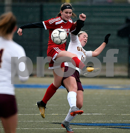 11/18/2017 Mike Orazzi | Staff Granby Memorial's Maria Nolan (11) and Berlin's Angela Perrelli (5) during the Class M Final at Municipal Stadium in Waterbury Saturday. Granby won 3-0.