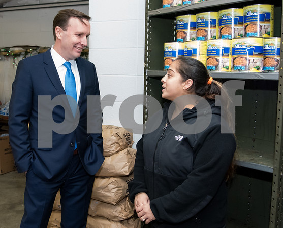 11/20/17 Wesley Bunnell | Staff HRA held its annual turkey distribution at the New Britain Food & Resource Center on Monday afternoon with help from workers and volunteers. Senator Chris Murphy talks with volunteer Lydia Colon.