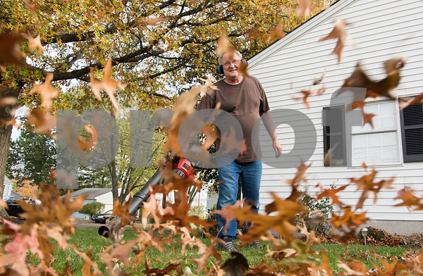 11/2/17 Wesley Bunnell | Staff Roger Michaud of Lowell St uses his leaf blower on Thursday afternoon to tidy up the yard.