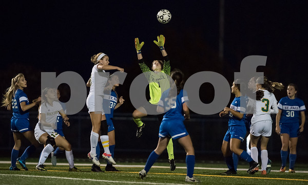 11/2/17 Wesley Bunnell | Staff St. Paul Catholic girls soccer vs Holy Cross in the NVL Championship game on Thursday evening at Seymour High School. Goal keeper Nina Zwolinski (1) goes up for the save.