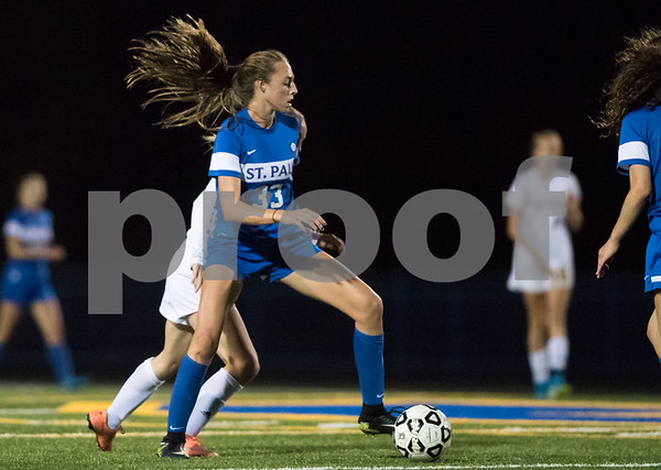 11/2/17 Wesley Bunnell | Staff St. Paul Catholic girls soccer vs Holy Cross in the NVL Championship game on Thursday evening at Seymour High School. Addison Davis (33).