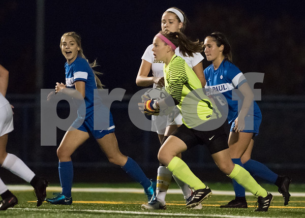 11/2/17 Wesley Bunnell | Staff St. Paul Catholic girls soccer vs Holy Cross in the NVL Championship game on Thursday evening at Seymour High School. Goal keeper Nina Zwolinski (1) after making a leaping save.