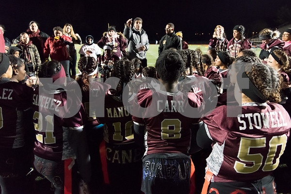 11/22/17 Wesley Bunnell | Staff Southington defeated New Britain in the annual Powder Puff game at Veterans Stadium in New Britain on Wednesday night. Coaches address the New Britain team after the game.