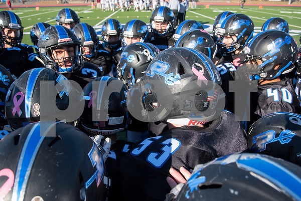 11/23/17 Wesley Bunnell | Staff Plainville football was defeated by Farmington on Thanksgiving morning for The Olde Canal Cup. Plainville players huddle up before the start of the game.