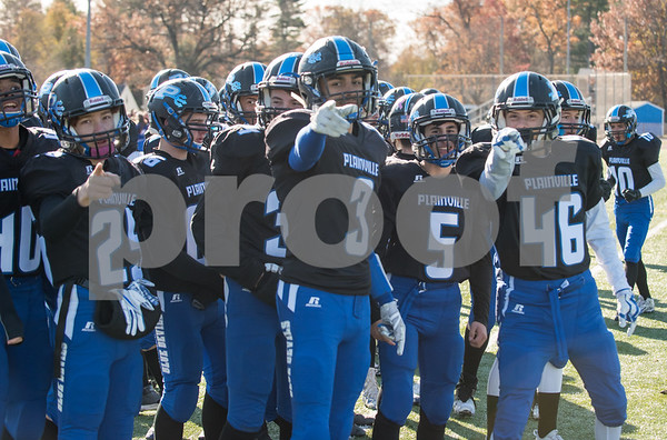 11/23/17 Wesley Bunnell | Staff Plainville football was defeated by Farmington on Thanksgiving morning for The Olde Canal Cup. Players point towards the end zone after a Ej Wynkoop (2) touchdown. Jason Riback (25), Ben Root (3), Dominic Pedrolini (5) and Tanner Callahan (46).