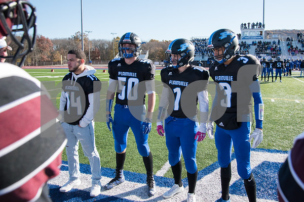 11/23/17 Wesley Bunnell | Staff Plainville football was defeated by Farmington on Thanksgiving morning for The Olde Canal Cup. Angel Wren (14), Nick Cianchetti (50), Cody Marquis (1) and Ben Root (3) at midfield for the coin toss.