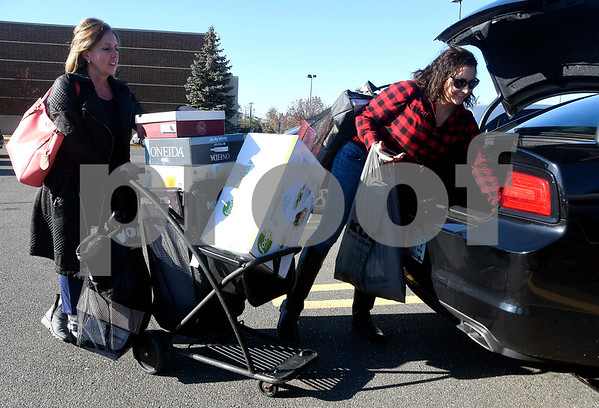 11/24/2017 Mike Orazzi | Staff Tina Mennone and her daughter Gianna while leaving the Kohls in Plainville after doing some Black Friday shopping Friday afternoon.