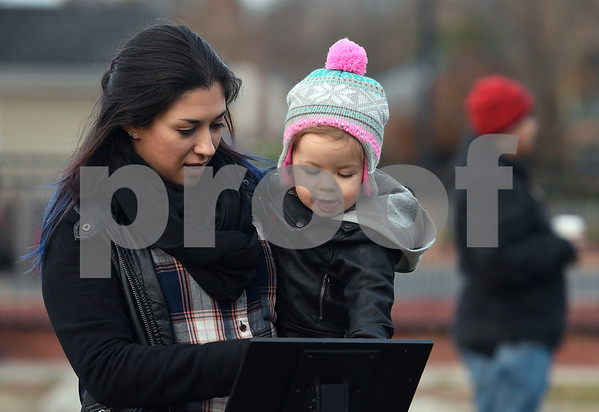 11/25/2017 Mike Orazzi | Staff Candra Civale and her daughter Alexia, 20 months, during the Town of Berlin Fire Department's annual tree lighting at the Veteran's Memorial Park Saturday evening.