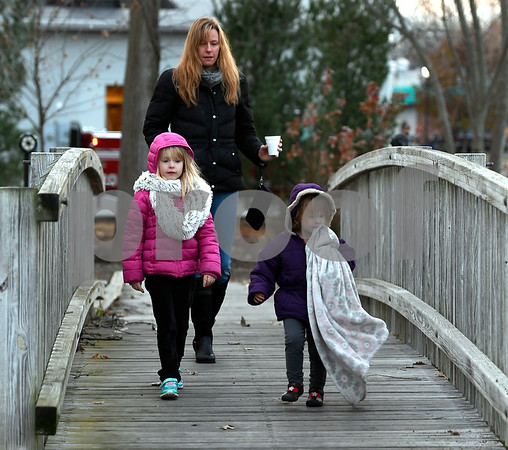 11/25/2017 Mike Orazzi | Staff Melissa Matteson and her daughters Alivia, 2 1/2, and Ava,5, arrive for the Town of Berlin Fire Department's annual tree lighting at the Veterans Memorial Park Saturday evening.