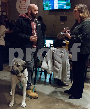 11/28/17 Wesley Bunnell | Staff The Community Foundation of Greater New Britain held a Giving Brewsday event at Alvarium Beer on Tuesday evening for young entrepreneurs to become involved in the foundation. Joe Cullen, L, stands with his dog Simon as he talks with Stephanie Frank from The Lions Club of New Britain.