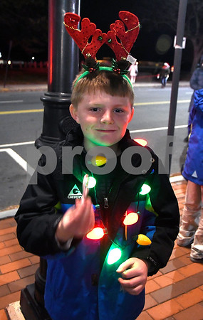 11/28/2017 Mike Orazzi | Staff Ethan Huppenbauer,7, during the 66th Annual Bristol Carol Sing and the 27th Holiday Lighting Ceremony in front of Webster Bank on Main Street in downtown Bristol Tuesday night.