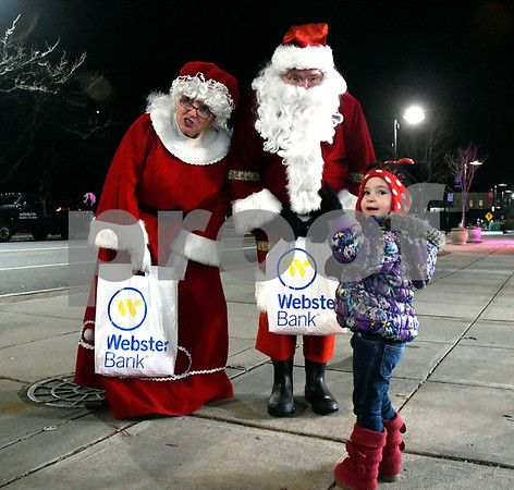 11/28/2017 Mike Orazzi | Staff Elana Ewings,3, meets with Santa and Mrs Claus during the 66th Annual Bristol Carol Sing and the 27th Holiday Lighting Ceremony in front of Webster Bank on Main Street in downtown Bristol Tuesday night.