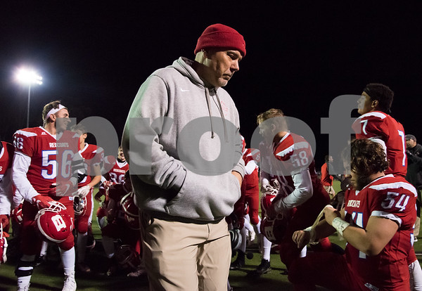 11/28/17 Wesley Bunnell | Staff Berlin football defeated Watertown in a playoff game on Tuesday night at Sage Park in Berlin. Head coach Joe Aresimowicz walks off the field after giving his post game speech to his players