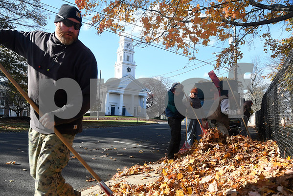11/9/2017 Mike Orazzi | Staff Workers from the St. Joseph Church Cemetery clean up leaves on Federal hill in front of the St. Joseph Church Thursday afternoon.