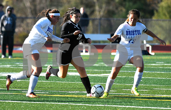 11/9/2017 Mike Orazzi | Staff Bristol Eastern's Julianna Larue (21) and Brooke Dauphinee (10) with Joel Barlow's Annie Tamallanca (29) during Thursday's Class L Second Round Girls Soccer in Bristol.