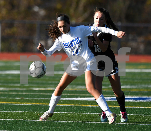 11/9/2017 Mike Orazzi | Staff Bristol Eastern's Kailey Laprise (14) and Joel Barlow's Lucy Witherbee (18) during Thursday's Class L Second Round Girls Soccer in Bristol.