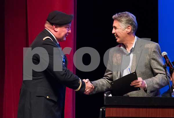 11/8/17 Wesley Bunnell | Staff The Berlin Public Schools held a Veterans Day Program titled Remembering Our History and Recognizing the Sacrifices of Our Veterans on Thursday evening at the Berlin High School auditorium. Veteran Guest Speaker Bradford Parsons of V.F.W. Post 10732 , L, receives a Proclamation from Mayor Mark Kaczynski.
