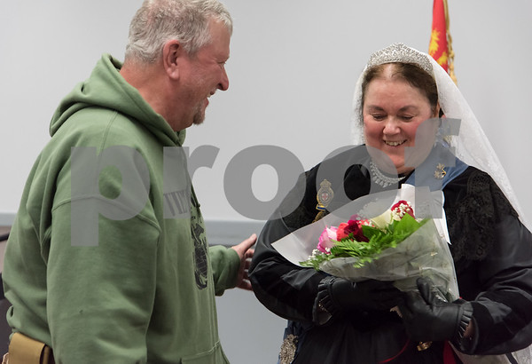 11/8/17 Wesley Bunnell | Staff Set in 1879 Sally Mummey performed as Queen Victoria, Queen of Great Britain and Empress of India at the Berlin-Peck Library on Thursday afternoon. John Callahan and his wife Diane presented flowers at the conclusion to Sally Mummey.