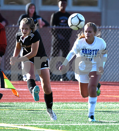 11/9/2017 Mike Orazzi | Staff Bristol Eastern's Megan Perry (18) and Joel Barlow's Amelia Blackwell (4) during Thursday's Class L Second Round Girls Soccer in Bristol.