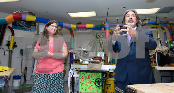 10/02/17 Wesley Bunnell | Staff The Middle School of Plainville held a ribbon cutting on Monday afternoon for the new STEAM lab which stands for science, technology, engineering and math. Technology teacher Kim Coyle stands with Principal Matthew Guarino inside of the manufacturing room with equipment used for testing visible behind them.