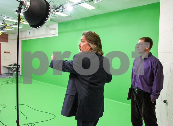 10/02/17 Wesley Bunnell | Staff The Middle School of Plainville held a ribbon cutting on Monday afternoon for the new STEAM lab which stands for science, technology, engineering and math. Principal Matthew Guarino stands with music teacher Todd Helming who also assists with video production in front of a large green screen.