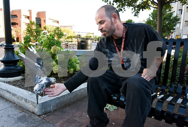 10/02/17 Wesley Bunnell   Staff Jose Matas has pigeons eating from his hand in Central Park on Monday afternoon.