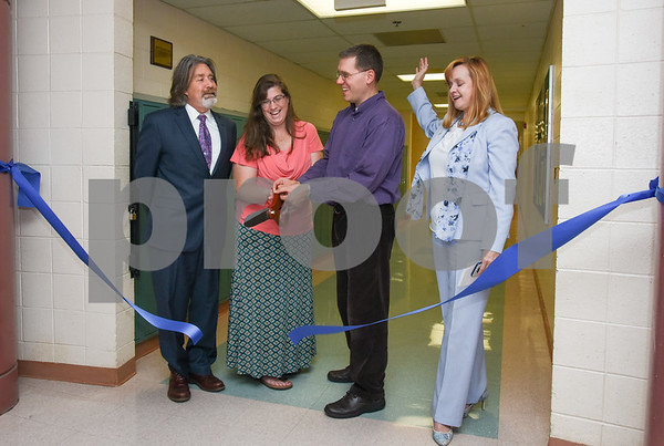10/02/17 Wesley Bunnell | Staff The Middle School of Plainville held a ribbon cutting on Monday afternoon for the new STEAM lab which stands for science, technology, engineering and math. Principal Matthew Guarino, L, Technology teacher Kim Coyle, Music teacher Todd Helming and Superintendent of Schools Dr. Maureen Brummett.