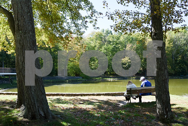 10/02/17 Wesley Bunnell   Staff Hilda Garcia and Yan Stachelek both of Bristol sit by the side of Page Park Lagoon on Monday afternoon.