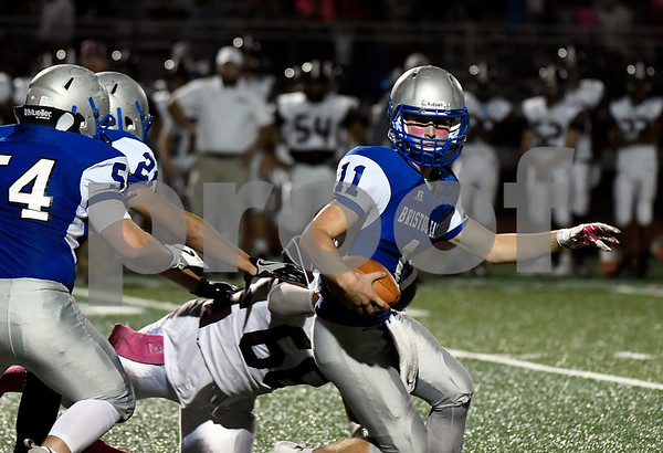 10/6/2017 Mike Orazzi   Staff Bristol Eastern's Justin Marshall (11) tackled by Farmington's Jermaine Carter (66) Friday night in Bristol.