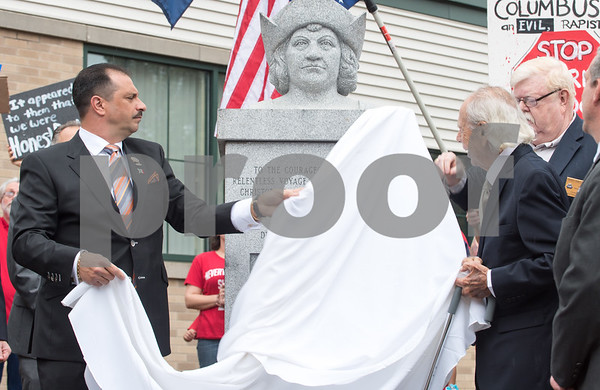 A ceremony was held on Monday morning at the Southington Municipal Center for the dedication and unveiling of the Christopher Columbus Monument honoring the 525th anniversary of the discovery of America. President of UNICO and Sons of Italy President Antonio Cusano, L, helps unveil the statue of Columbus with the help of Dick Fortunato.