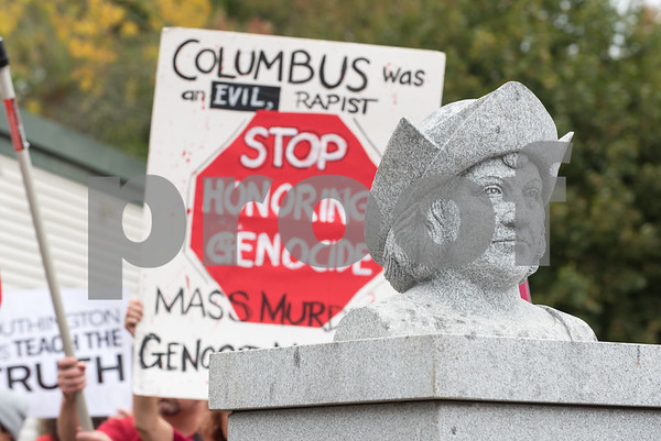 A ceremony was held on Monday morning at the Southington Municipal Center for the dedication and unveiling of the Christopher Columbus Monument honoring the 525th anniversary of the discovery of America. Protestors hold up signs after the unveiling.