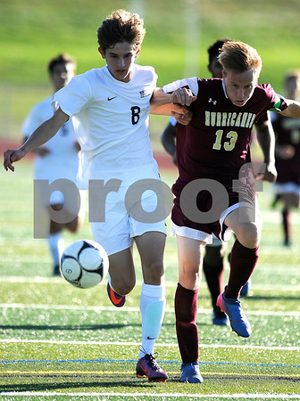 10/10/2017 Mike Orazzi | Staff Bristol Central's David Bowes (8) and New Britain's Nick Makuch (13) during Tuesday's soccer at Bristol Central.
